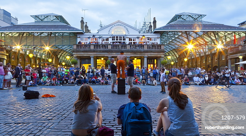 Crowd watching street performers at Covent Garden, London, England, United Kingdom, Europe