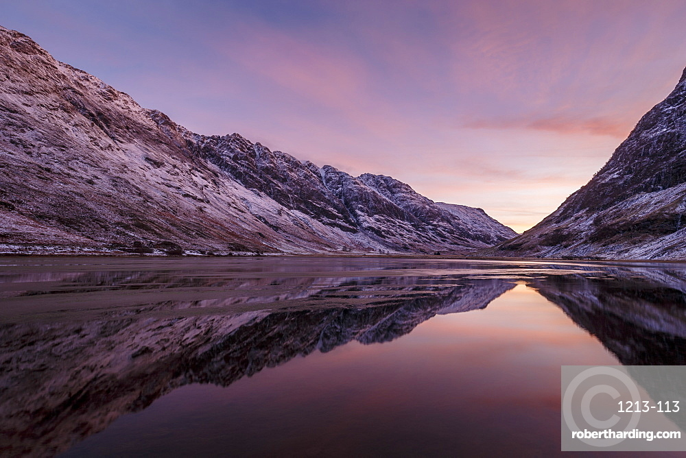Loch Achtriochtan in winter with snow-capped mountains and reflections, Glencoe, Highlands, Scotland, United Kingdom, Europe