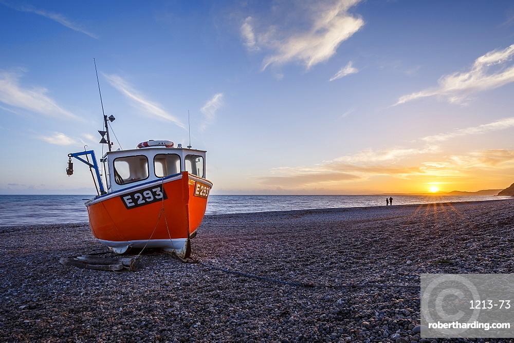 Fishing boat moored on Branscombe Beach at sunset, Seaton, East Devon, England, United Kingdom, Europe