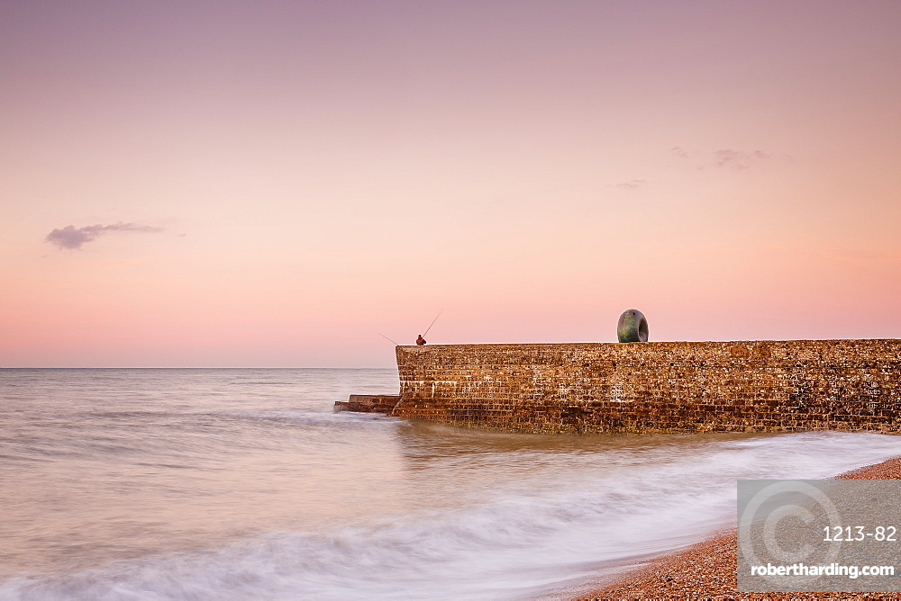 Fisherman and the Green Doughnut sculpture at dawn on Brighton Seafront, Brighton, East Sussex, England, United Kingdom, Europe