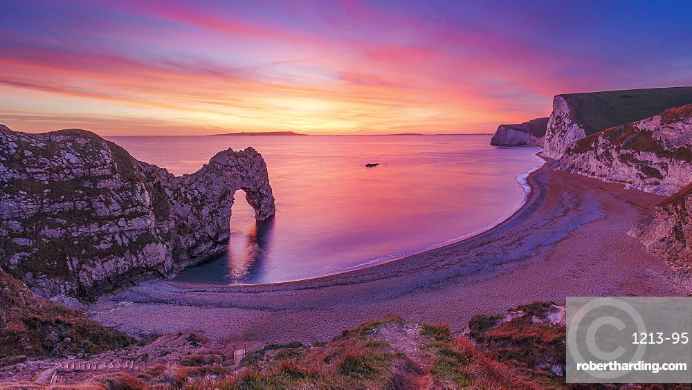 A stunning sunset over Durdle Door on the Jurassic Coast, UNESCO World Heritage Site, Dorset, England, United Kingdom, Europe