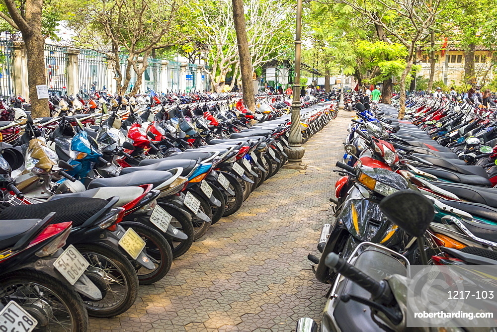 Rows of motorbikes parked in central Ho Chi Minh City (Saigon), Vietnam, Indochina, Southeast Asia, Asia