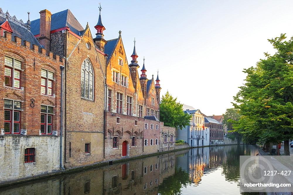 Brugse Vrije and buildings along the Groenerei canal at dusk, Bruges (Brugge), West Flanders (Vlaanderen), Belgium, Europe