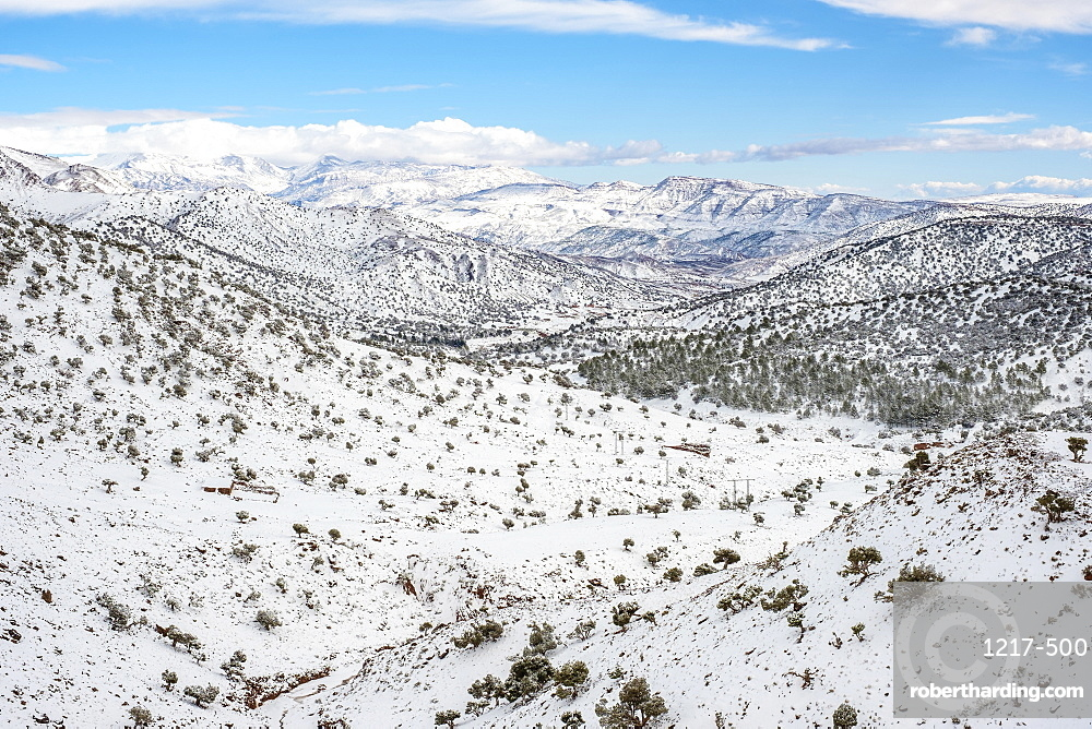Morocco, SoussMassa (Sous-Massa-Draa), Ouarzazate Province. Atlas Mountains landscape during winter snow.
