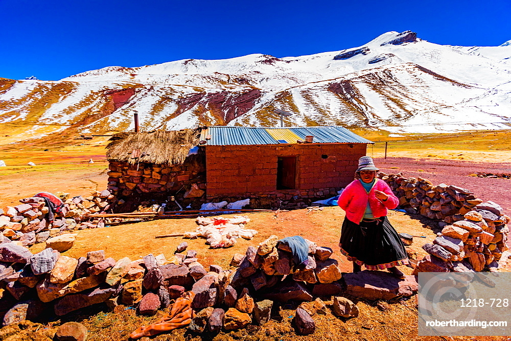 A woman by her shack on Rainbow Mountain, The Andes, Peru, South America