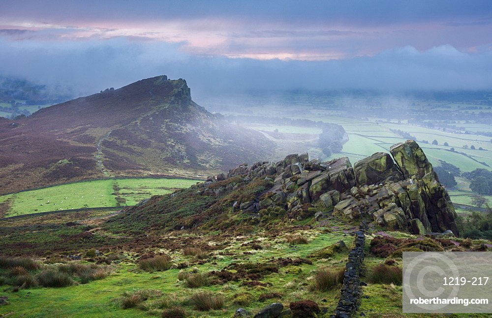 Morning mist and fog clear the landscape to reveal Hen Cloud and the gritstone rocks of the Roaches