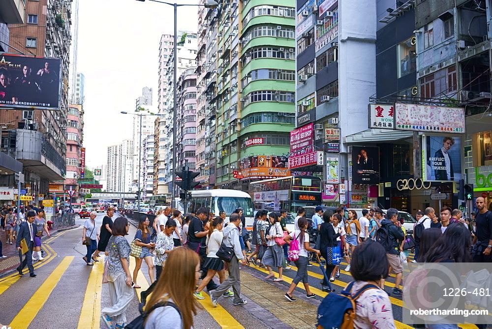 A busy street in Mong Kok (Mongkok), Kowloon, Hong Kong, China, Asia