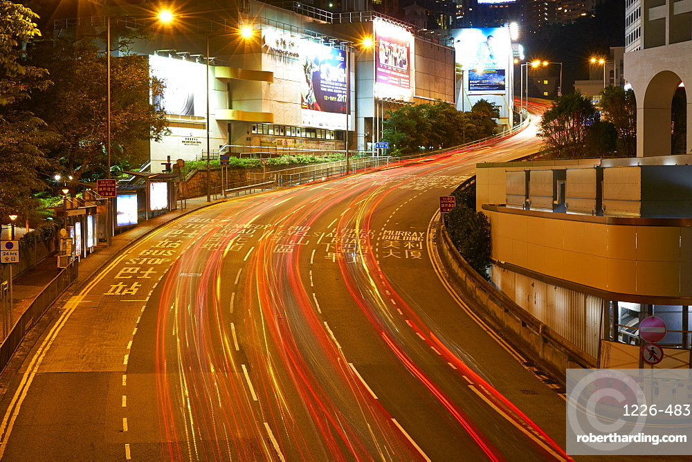 Car light trails on a busy road in Central, Hong Kong Island by night, Hong Kong