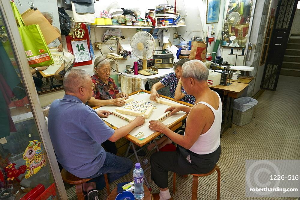 Elderly couples playing Mahjong, Hong Kong, China, Asia