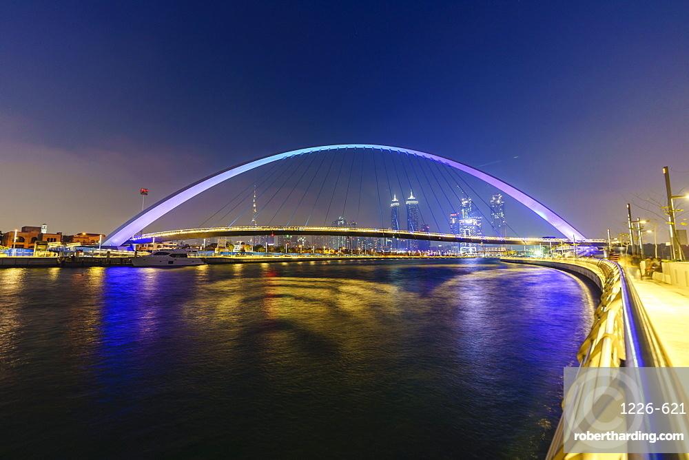 Tolerance Bridge, a pedestrian bridge spanning Dubai Water Canal illuminated at night, Business Bay, Dubai, United Arab Emirates, Middle East