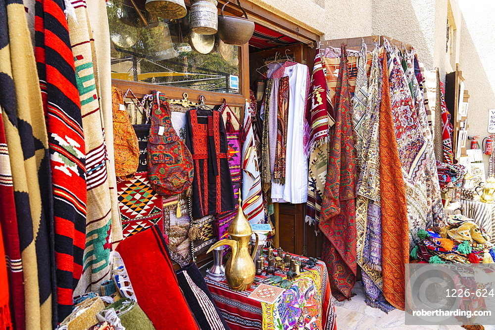 Colourful rugs and carpets for sale in Al Fahidi Historic Neighbourhood, Bur Dubai, Dubai, United Arab Emirates