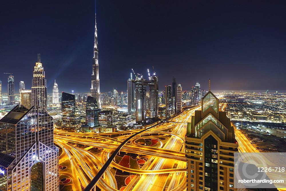 Dubai skyline and Sheikh Zayed Road Interchange by night, Dubai, United Arab Emirates