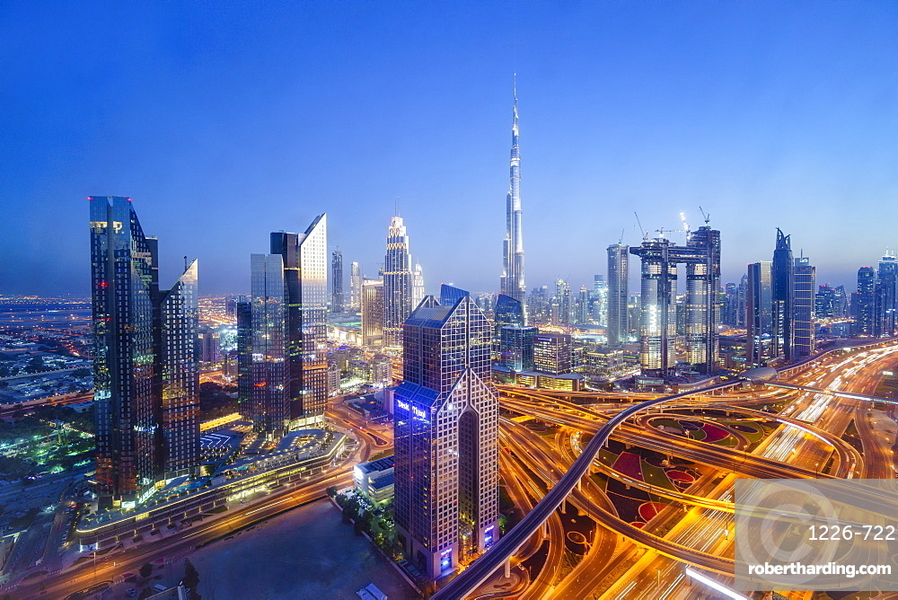 Dubai skyline with Burj Khalifa and Sheikh Zayed Road Interchange, Dubai, United Arab Emirates, Middle East