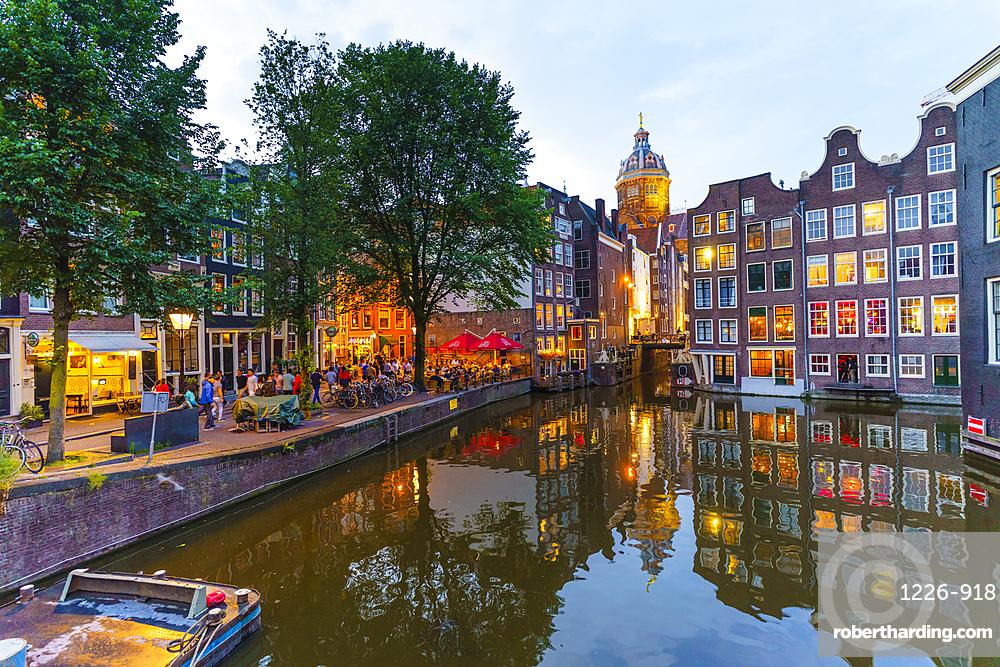 Restaurants by a canal at dusk, Oudezijds Kolk, Amsterdam, Netherlands