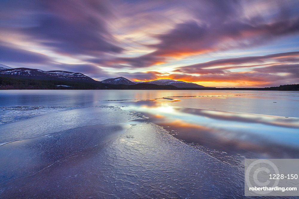 Ice sheets and sunset at Loch Morlich, Glenmore, Scotland, UK.
