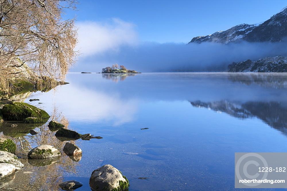 Norfolk Island shrouded in mist, Ullswater, Lake District National Park, UNESCO World Heritage Site, Cumbria, England, United Kingdom, Europe