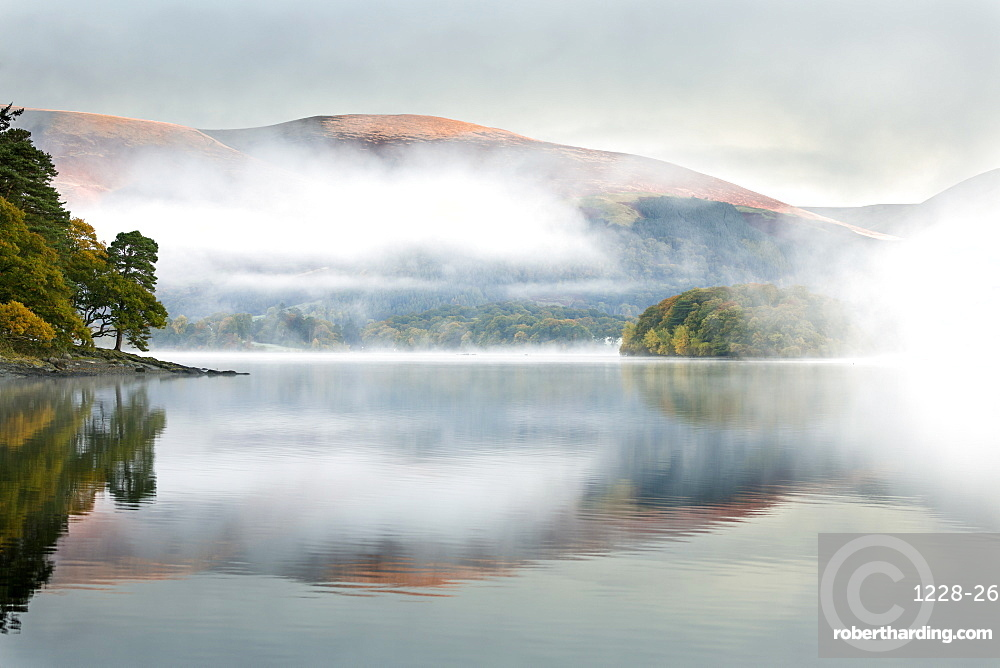 Mist over Derwent Water at dawn, from Brandlehow, Borrowdale, The Lake District National Park, Cumbria, England, United Kingdom, Europe