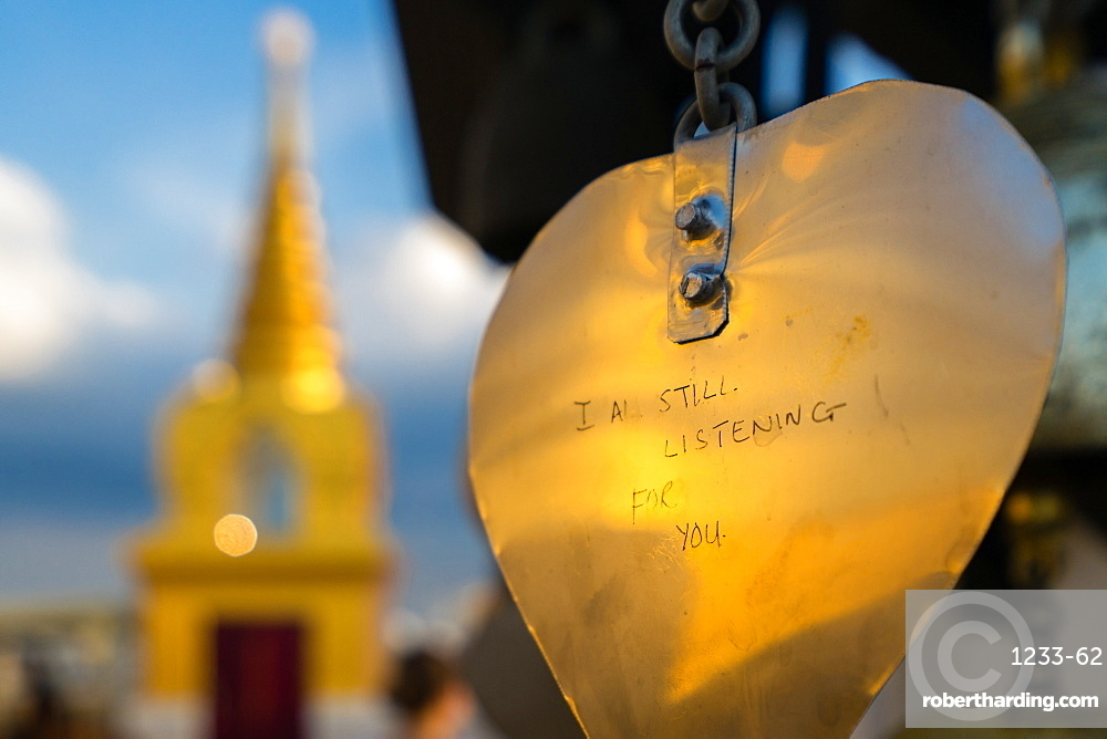 Golden prayer flag etching with Buddhist gold stupa in background, Bangkok, Thailand, Southeast Asia, Asia