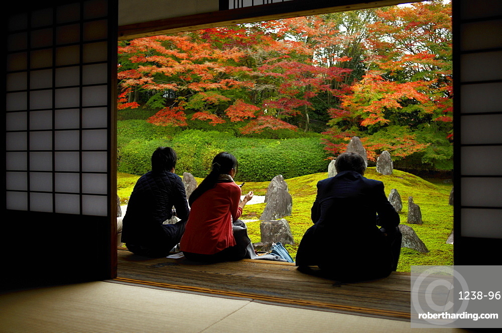 Visitors silently watching moss and rock garden, Komyo-in temple, Kyoto, Japan, Asia