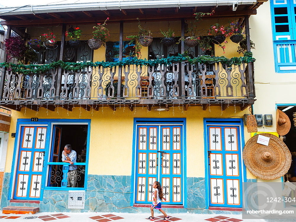 Housefront with man and girl, Filandia, Coffee Region, Colombia, South America