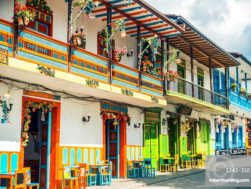 Colorful houses line the Parque Principal, Jardin, Antioquia, Colombia, South America