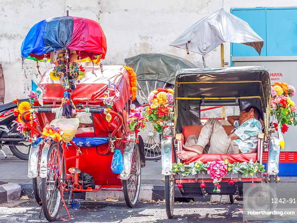 Resting rickshaw driver, Georgetown, Penang, Malaysia, Southeast Asia, Asia