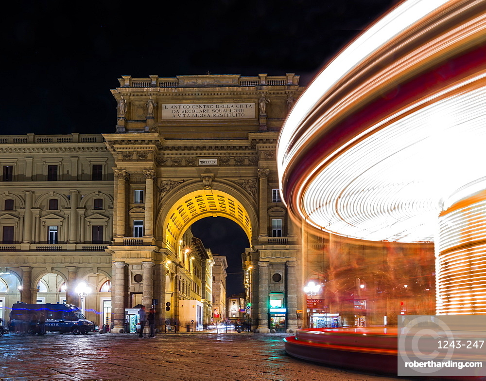 Long exposure of carousel at night in Florence, Tuscany, Italy, Europe