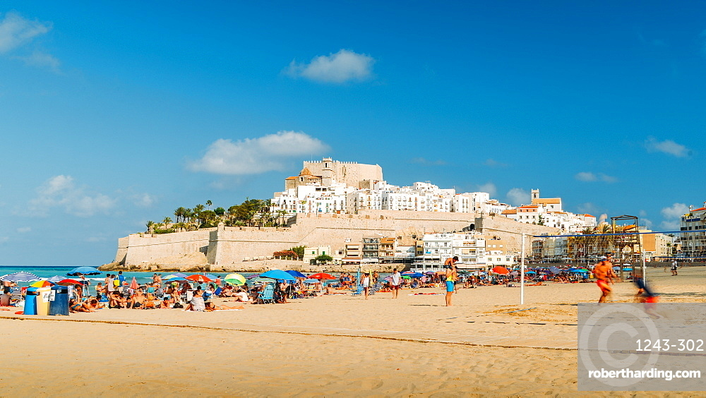 Crowded beach and the medieval fort town of Peniscola, Castellon, Spain, Europe