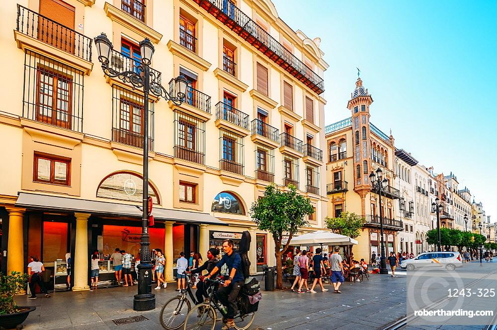 Pedestrians and cyclists on Avenida de la Constitucion in the historic centre of Seville, Andalusia, Spain, Europe