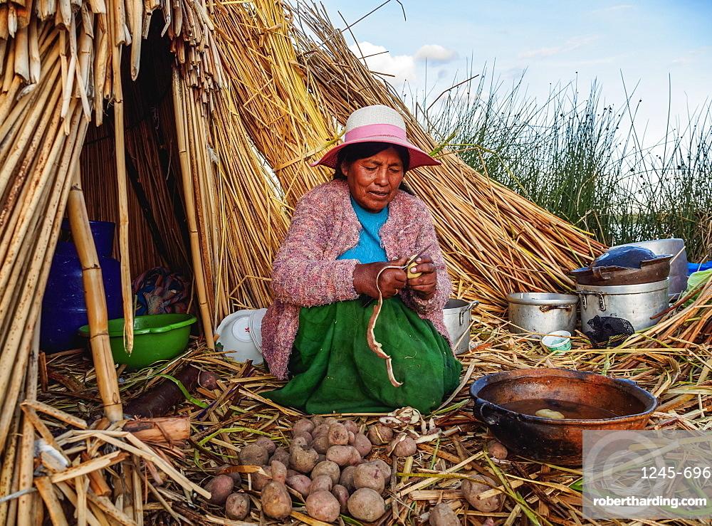 Native Uro Lady cooking, Uros Floating Islands, Lake Titicaca, Puno Region, Peru, South America
