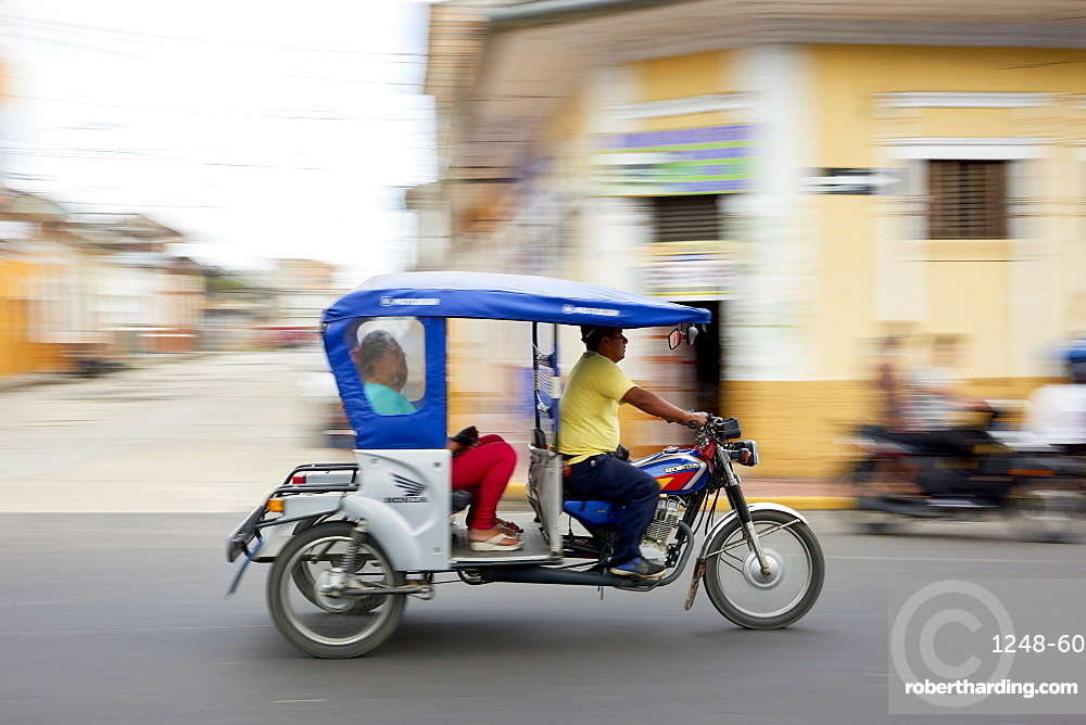 Panned shot of mototaxi in Iquitos, Peru, South America