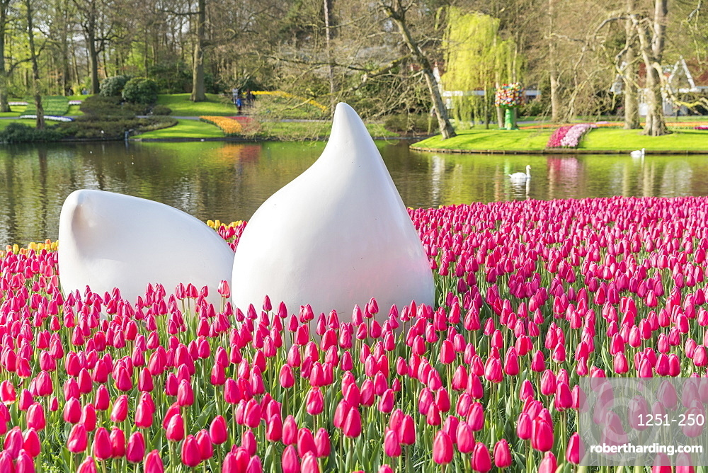 Bulblike sculpture and pink tulips at Keukenhof Gardens, Lisse, South Holland province, Netherlands, Europe