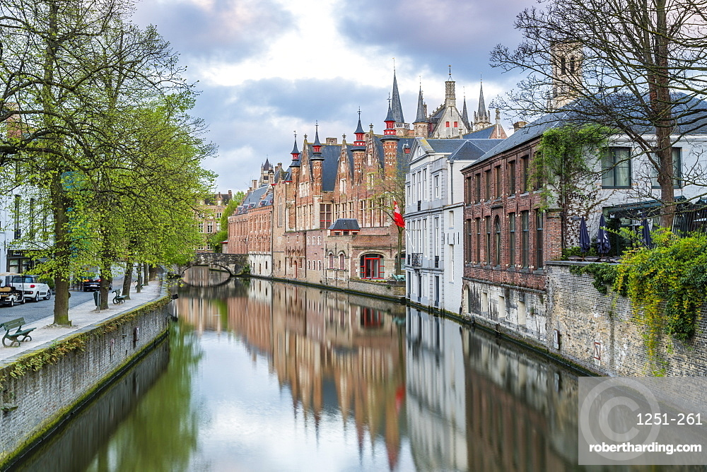 Houses and bridge reflected in the Groenerei canal, Bruges, West Flanders province, Flemish region, Belgium, Europe