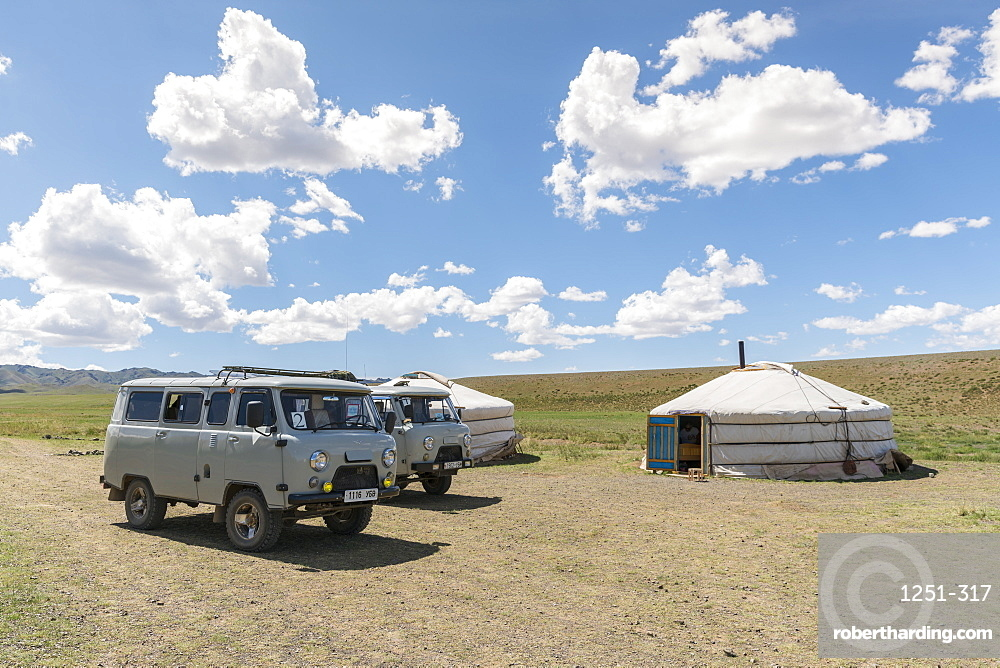 Mongolian traditional nomadic gers and soviet minivans. Bayandalai district, South Gobi province, Mongolia, Central Asia, Asia