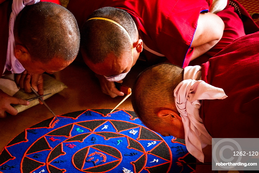 Buddhist monks of the yellow hat tradition making a sand mandala, Gyuto Tantric Monastery, Dharamsala, Himachal Pradesh, India, Asia