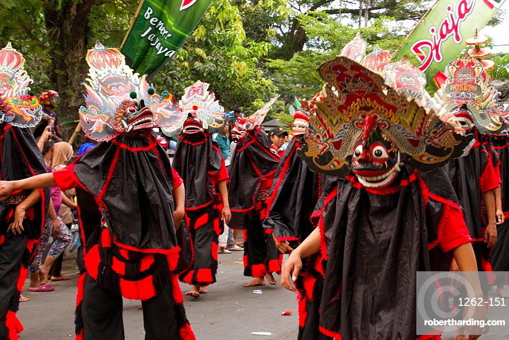 Indonesian men in masks taking part in a carnival celebrating Malang's 101st year anniversary, Malang, East Java, Indonesia, Southeast Asia, Asia
