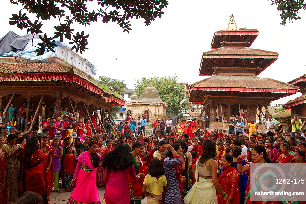 Women of Nepal celebrate Teej, a festival which blesses the men in their lives, Durbar Square, Kathmandu, Nepal
