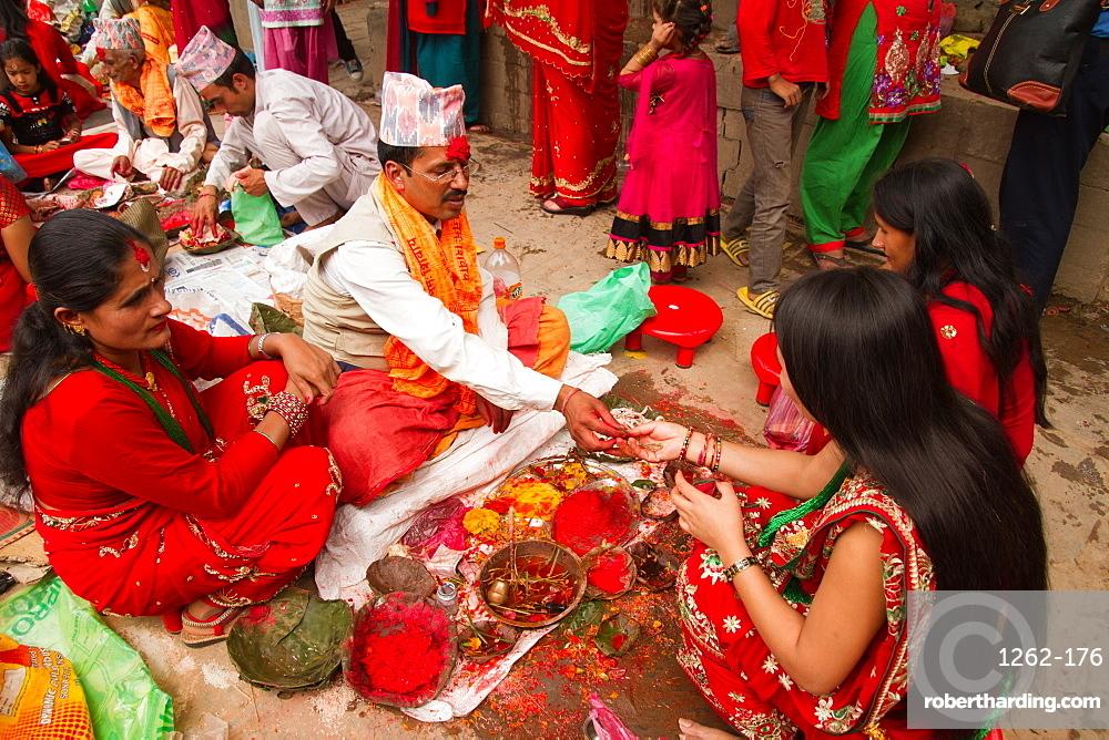 Women of Nepal celebrate Teej, a festival which blesses the men in their lives, Durbar Square, Kathmandu, Nepal, Asia