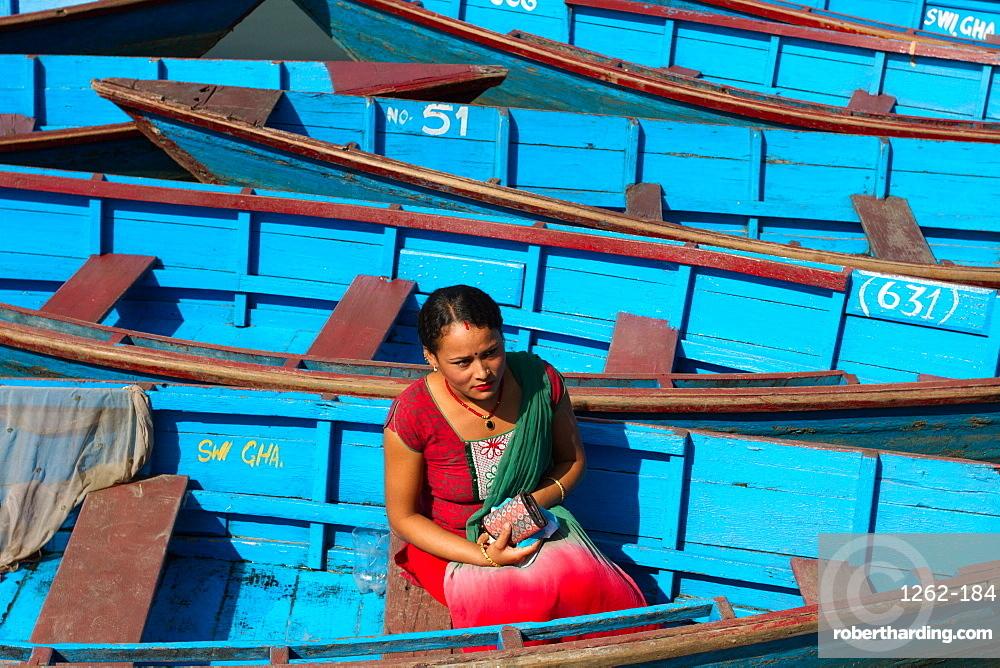 Nepalese woman and boats of Phewa Lake, Pokhara, Nepal, Asia