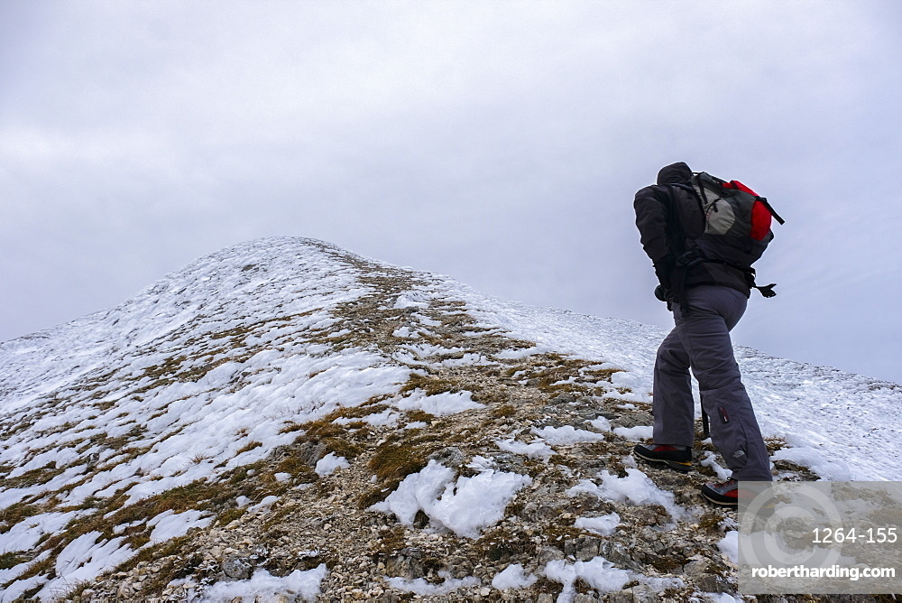 Italy, Umbria, Apennines, Hiker on Mt Catria in Winter
