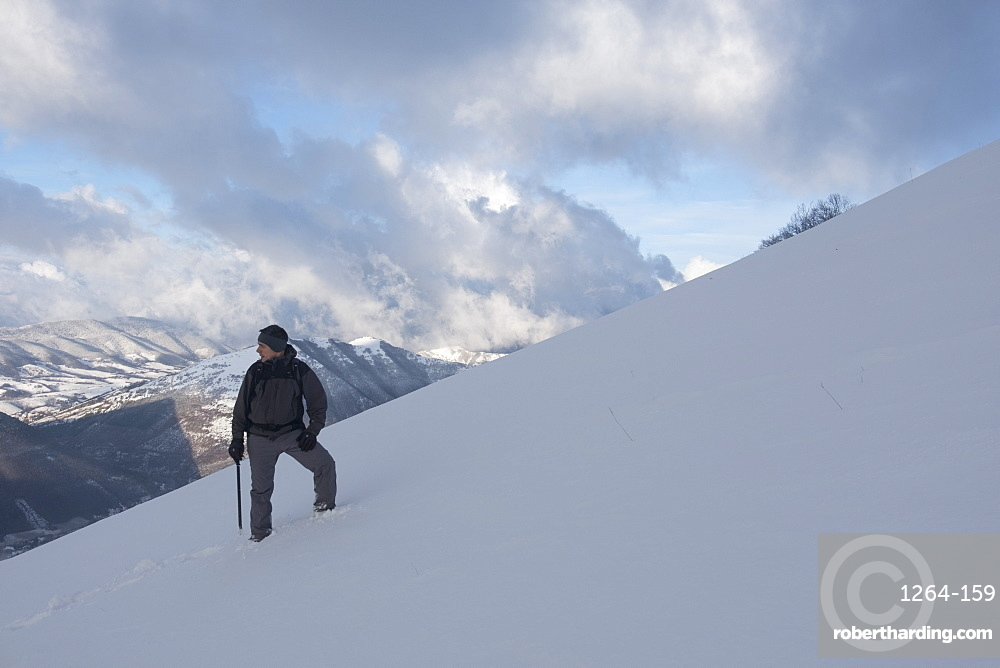 Hiker in winter, Motette, Umbria, Italy, Europe