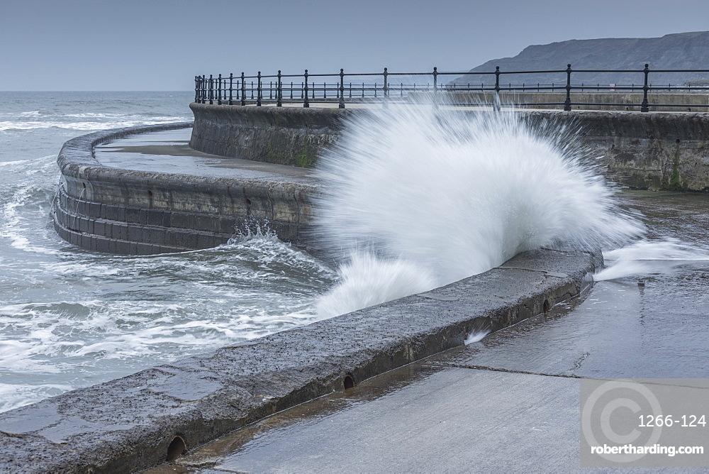 Waves crashing into the sea wall at Scarborough, North Yorkshire, Yorkshire, England, United Kingdom, Europe