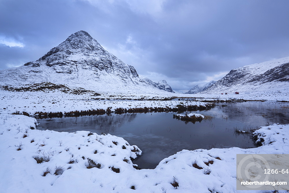 View to a snow covered Buachaille Etive Beag from Lochan na fola close to the A82 through Glencoe, Lochaber, Highlands, Scotland, United Kingdom, Europe