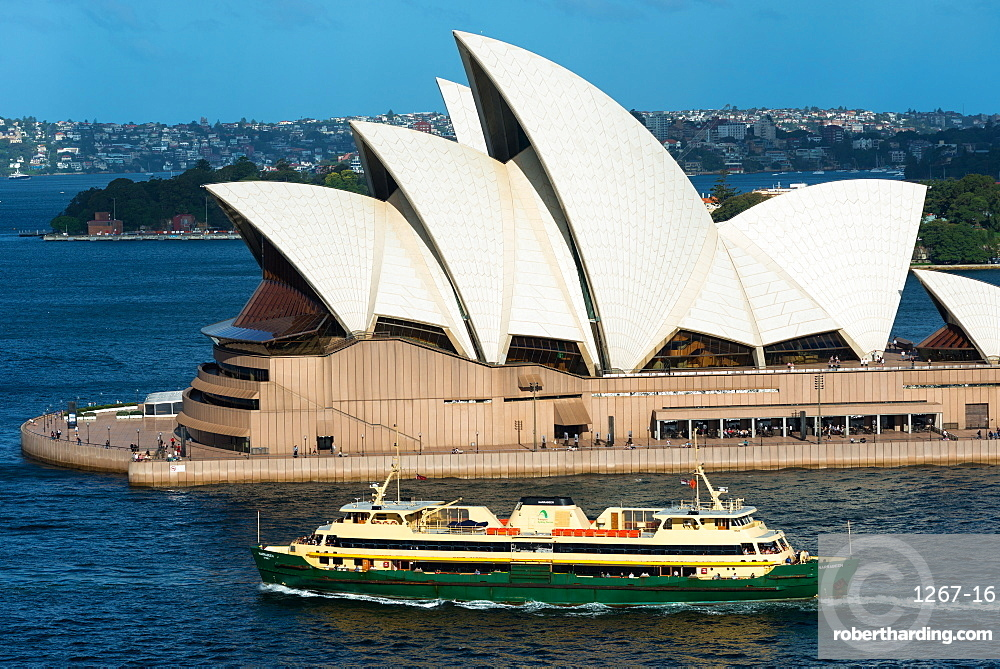 Manly ferry goes past Sydney Opera House, New South Wales, Australia.