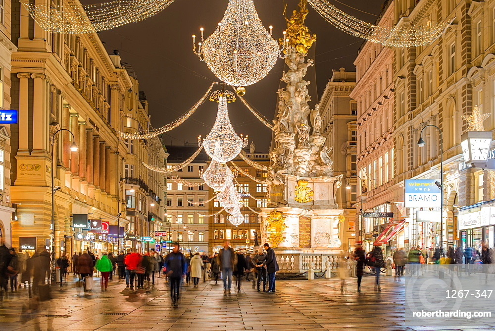 Christmas illuminations after dark on Vienna's city centre thoroughfare the Graben. Austria.