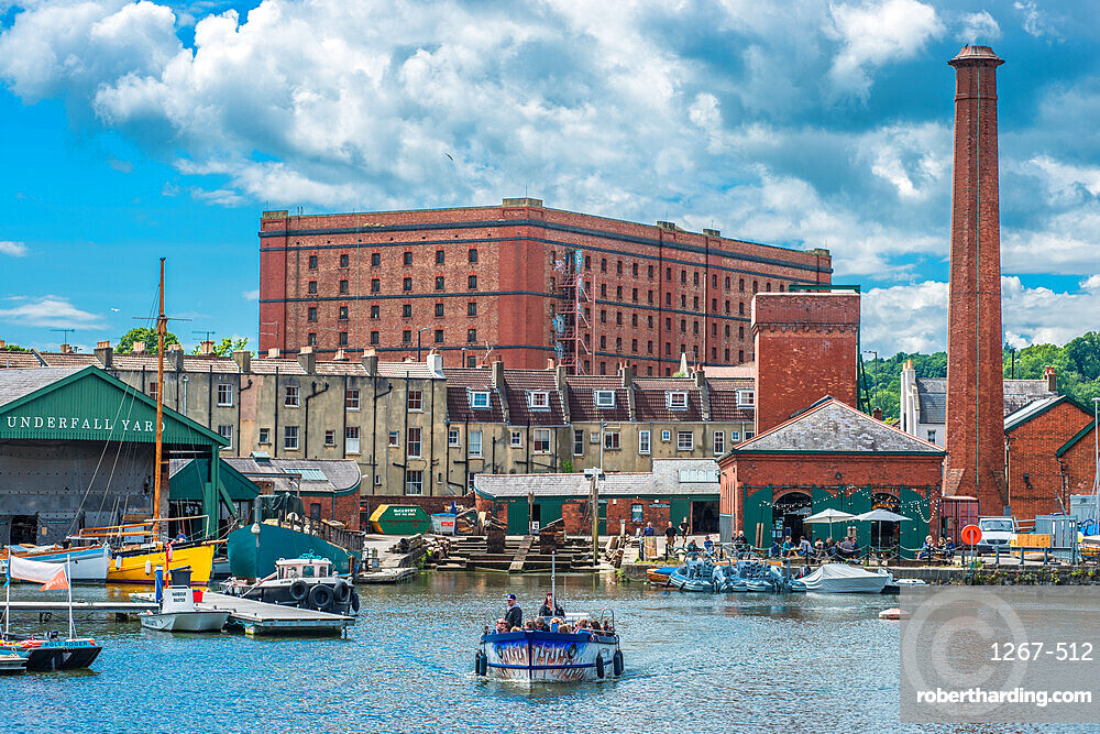 Floating Harbour at Underfall Yard with Victorian pump room & an old tobacco warehouse to the rear, Bristol, Avon, England, UK.