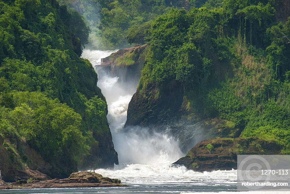 Water cascades down Murchison Falls and into the River Nile, Uganda, Africa