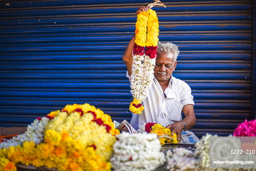 Selling flowers by a temple at at market in Munnar, Western Ghats Mountains, Kerala, India, Asia