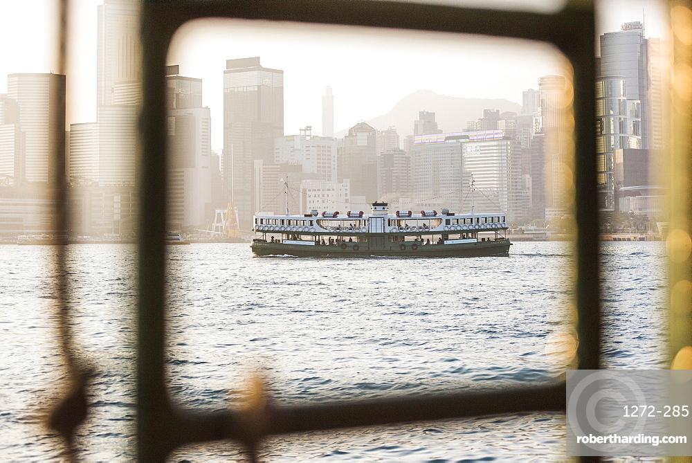 Star Ferry at sunset, between Hong Kong Island and Kowloon, Hong Kong, China, Asia
