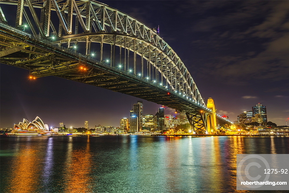 Night cityscape of Sydney, showing the city skyline, the Sydney Harbour Bridge and the Sydney Opera House, Sydney, New South Wales, Australia, Pacific
